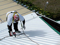 worker working on the roof sealing